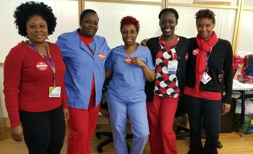 Harlem health center staff wear red on day of demonstration