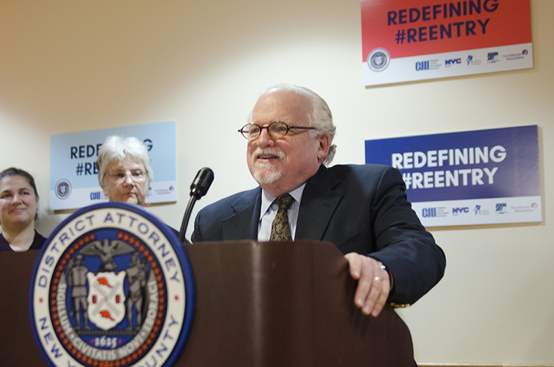 Dr. Calman speaking at podium for DA Vance press conference