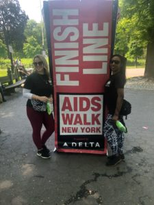 "Women standing next to ""Finish line"" sign."